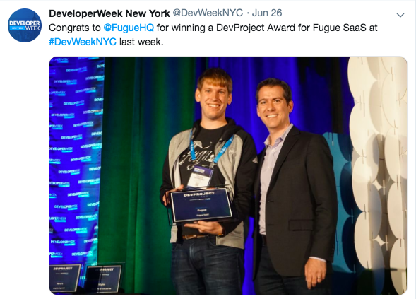 Tyler Drombosky, Principal Engineer, accepts the DevProject award.
